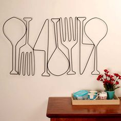 Food For Thought Made out of Mild steel, hand painted and hand bent, kitchen metal wall art by DesignMint is sure to become a conversation piece. Best suited in cafes, restaurants, kitchen areas and cooking studios. Add Food For Thought to bring a touch of whimsy to your space.