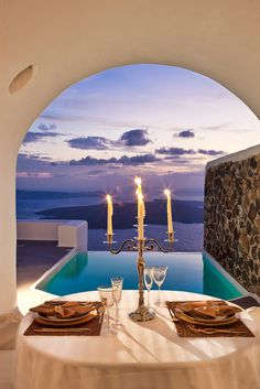 Romantic Evenings in Santorini... great idea for a holiday | DREAM homes & locations, visit http://www.pinterest.com/davidos193/