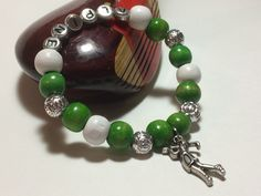 Wear the pride in your favorite golf or country club on your wrist with a customized Player Pride Bracelet!  Each beautiful, customized bracelet has a female golfer charm surrounded by beads in your choice of colors and & silver lantern beads!