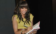 Tia signing copies of her book. We love her! http://blog.thebump.com/2012/05/02/bring-your-baby-matinee-with-tia-mowry/#slideshow=6