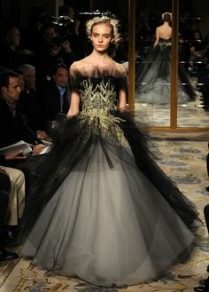 Marchesa Fall 2012. Black tulle overlay, gold bodice detail, full skirt.