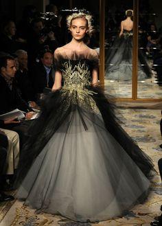 Marchesa Fall 2012. Black tulle overlay, gold bodice detail, full skirt.