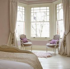 Obviously not these colors of this style, but I like the bay window curtain rod and the long curtains