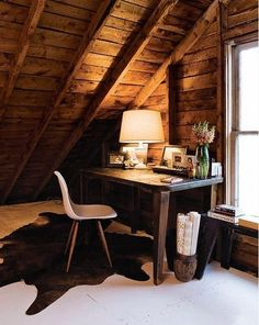 "There's something ""modern fairy tale""-like about this home office in a log cabin attic. It looks so warm and snug. I wonder what the view is like."