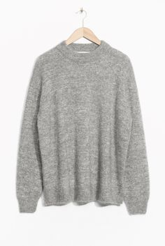 At first glance this grey jumper might look exactly like the one that's been lurking in the back of your drawer for years, but with a subtle sparkle thanks to metallic threading, this chic knit is an elegant, shimmering addition to your winter layering pieces.& Other Stories sparkling knit, £65 #refinery29 http://www.refinery29.uk/best-knitwear-winter-2016#slide-3
