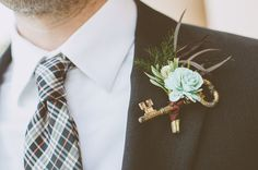 boutonniere with old keys and a succulent