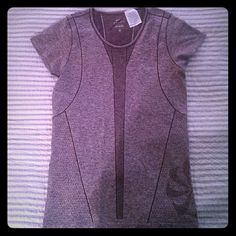 Nike DRI-FIT short sleeved top Heather grayish-purple . Never worn but tags have been removed and it has been washed once. Nike Tops Tees - Short Sleeve