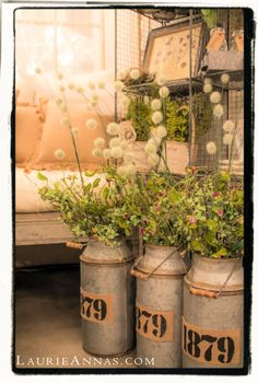 Whimsical flowers and galvanized jugs nestled in a corner at LaurieAnna's Vintage Home.