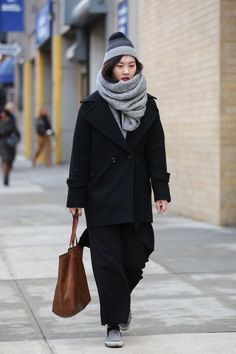 Neutral hues with a bold, red lip. #refinery29 http://www.refinery29.com/2015/02/82279/new-york-fashion-week-2015-street-style-pictures#slide-136