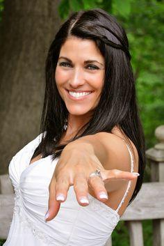 Bride showing wedding ring by BobGantchev