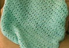 This baby blanket was my first real knitting project from a pattern. It was very simple and quick, but turned out very beautiful and soft!  ...