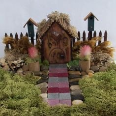 Fairy Garden or Gnome garden with mossy lawn