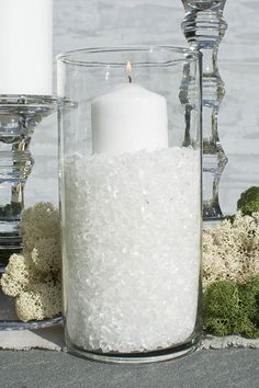 Our crushed glass filler is shown here with a variety of clear glass table decor, event candles and natural mosses.
