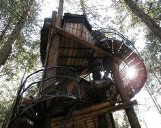 The treehouse in Canada's Enchanted Forest theme park looks like a children's picture book come to life. British Columbia's tallest treehouse is supported by several tree trunks and boasts a long spiral staircase that connects the structure's multiple levels