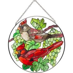 Joan Baker Designs LC269 Cardinals and Green Grapes Art Glass Suncatcher, 6-1/2-Inch Diameter by Joan Baker Designs. $23.00. Translucent artwork looks beautiful from inside or outside the window. Vivid translucent color for window display. Hand-painted. Clusters of green grapes create a shady perch for crimson cardinals on this hand-painted art glass Suncatcher. for more than 40 years, Joan Baker Designs' talented artisans have created stunning decorative art gla...