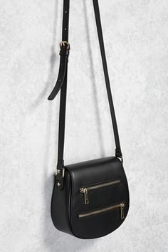7161073b8f A faux leather crossbody featuring an adjustable shoulder strap