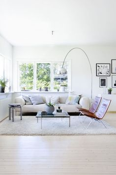 Arco provides a focal point for this spacious, sunlit living room.