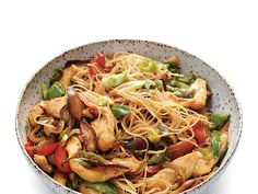 Learn how to make Chicken and Rice Noodle Stir-Fry with Ginger and Basil . MyRecipes has 70,000+ tested recipes and videos to help you be...