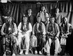 Standing L-R: Porcupine (aka Harvey White Shield), Stick (aka Joey Hamilton), Yellow Man (aka Robert Burns) Sitting L-R: Wolf Robe, Little Hand, Yellow Bear, White Eagle, Mower - Southern Cheyenne – 1909