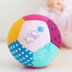 Make these cute patchwork play balls for your next baby shower. This is an easy, hand-sewn project!