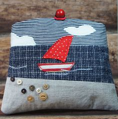 Handmade nautical clutch bag with a seaside scene made from panels of furnishing textile offcuts and a blue and white wool skirt (for the sea).