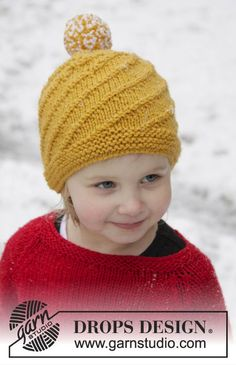 "Knitted DROPS hat with spiral pattern in ""Alaska"". Size 1-12 years ~ DROPS Design"