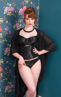 A delicious black satin lingerie set is number one on every girl's wish list! Our Glamour Nouveau lingerie has got everything going for it - a beautifully crafted art deco inspired Bra, a sexy little Waspie to winch in your waist and the ideal Shapewear for every occasion. Miss Deadly Red wears it here with one of our Elizabeth Kaftans and some Maitresse Knickers for complete  vintage allure