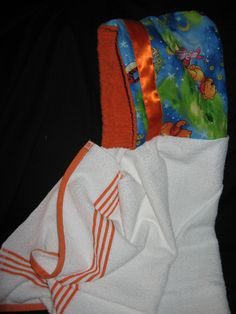 We have taken the bath towel to the next step. You can create your own theme for your towel. Each towel has a border added of the theme used along the edges of the towel. A Tie strap keeps it on your little one while they run a5ay from you in delight to wear our Peek-a-Boo Towel just a little bit longer. Price $24.99(Full sized bath towel)