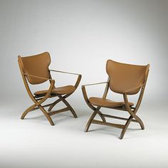 Poul Hundevad; Leather, Teak and Brass Chairs for George Tanier, 1951.