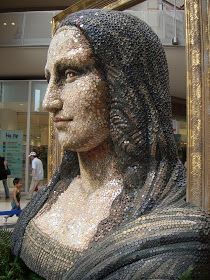 Mona Lisa in 3-D, made of buttons! - from P8 Buttons & Fabrics: Button Wednesday; This is a huge statue inside the Hankyu shopping center in Kobe, Japan.