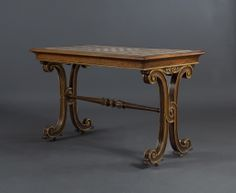 An Interesting Rosewood And Parcel Gilt Inlaid Center Table With Chessboard Specimen Marble Top.  English. Circa 1825.