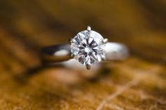 Diamond solitaire style engagement ring