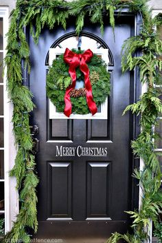 DIY:: Framed Christmas Wreath on the Front Door and porch decor! | My favorite thing about this is actually the Merry Christmas decal on the door.