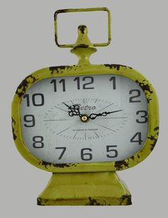 Relógio (despertador) vintage amarelo Linha Home Marcia Mello. #decoracao http://loja.marciamello.com.br/casa/relogios