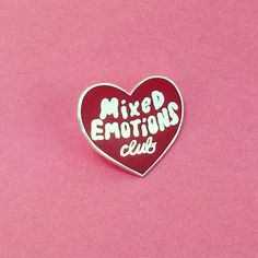 For the proudbadge carrying member of the Mixed Emotions Club. Features shiny silver metal with tomato red hard enamel that...