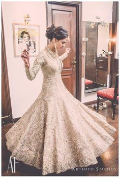 Wedding Twirling Lehengas - Champagne Gold Wedding Anarkali with Lace Cut Work and Sequins Work | WedMeGood | Photo Courtesy: Art Studio #wedmegood #twirling #lehenga #bridal #champagne