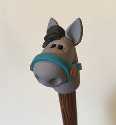 Polímero arcilla gris caballo pluma