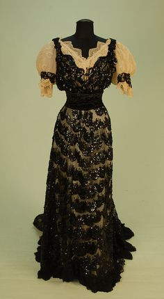 BLACK SEQUINNED NET EVENING GOWN with TRAIN, c. 1900.