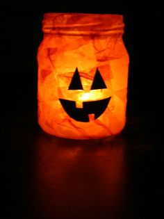 Easy Jack-O-Lantern candle jar. The tissue paper on the jar actually helps cool the jar, so you can handle it even with a lit candle inside!
