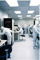 Workers outfitted in cleanroom garments