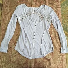 Free people long sleeve top NWT (tag fell off but I have it, also pictured) free people light peri top. Worn once (too small for me) and the back lace came undone (I sewed it back so you can hardly tell but I posted a picture so you can see it) reflected in price. Very soft and so pretty but just doesn't fit me. Free People Tops Tees - Long Sleeve