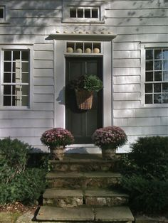 Charming autumn display!  Notice the pumpkins over the door on the transom windowsill...!