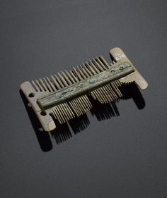 Comb of bone from Freswick Links, Caithness, Viking period, 800 - 1100 AD.