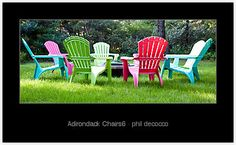 fire pit with multi-colored Adirondack chairs