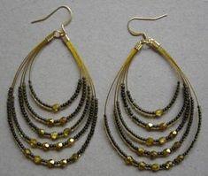 Boucles d'oreilles pendantes rocaille et facettes.