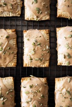 Fresh and flakey homemade Pumpkin Butter Pop Tarts with a cinnamon icing and pepitas. Woah.
