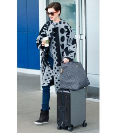 @Who What Wear - Anne Hathaway                 A comfy coat, like Hathaway's printed gray and black version, is great for chilly flights and even colder destinations. The actress' luxe accessories, specifically Fendi's Colorblock Square Acetate Sunglasses ($340) and MZ Wallace's Large Metro Tote ($195) in Metro, make for a stylish finish.