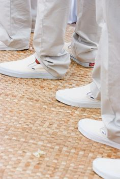 Groomsmen in Matching, Tan Slacks with Slip-On Shoes | Photography: Stewart Pinsky Photography. Read More: http://www.insideweddings.com/weddings/all-white-destination-beach-wedding-in-hawaii/274/