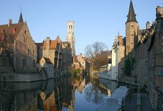 Bruges canal with famous belfry in view