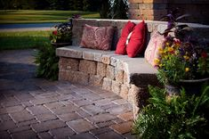 Put around our fire pit in backyard. I love this built-in seating area in lieu of a retaining wall!  Genius!